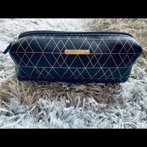 Stella & Dot gold geometric print make-up case